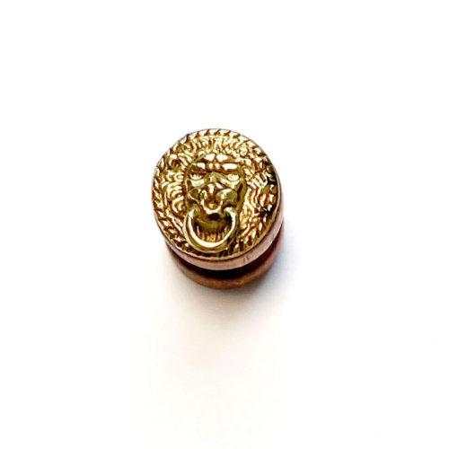 Fals dilatador de fusta + lleó daurat