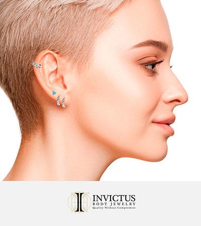 Piercings de oro macizo de Invictus en ZUK Luxury Piercing